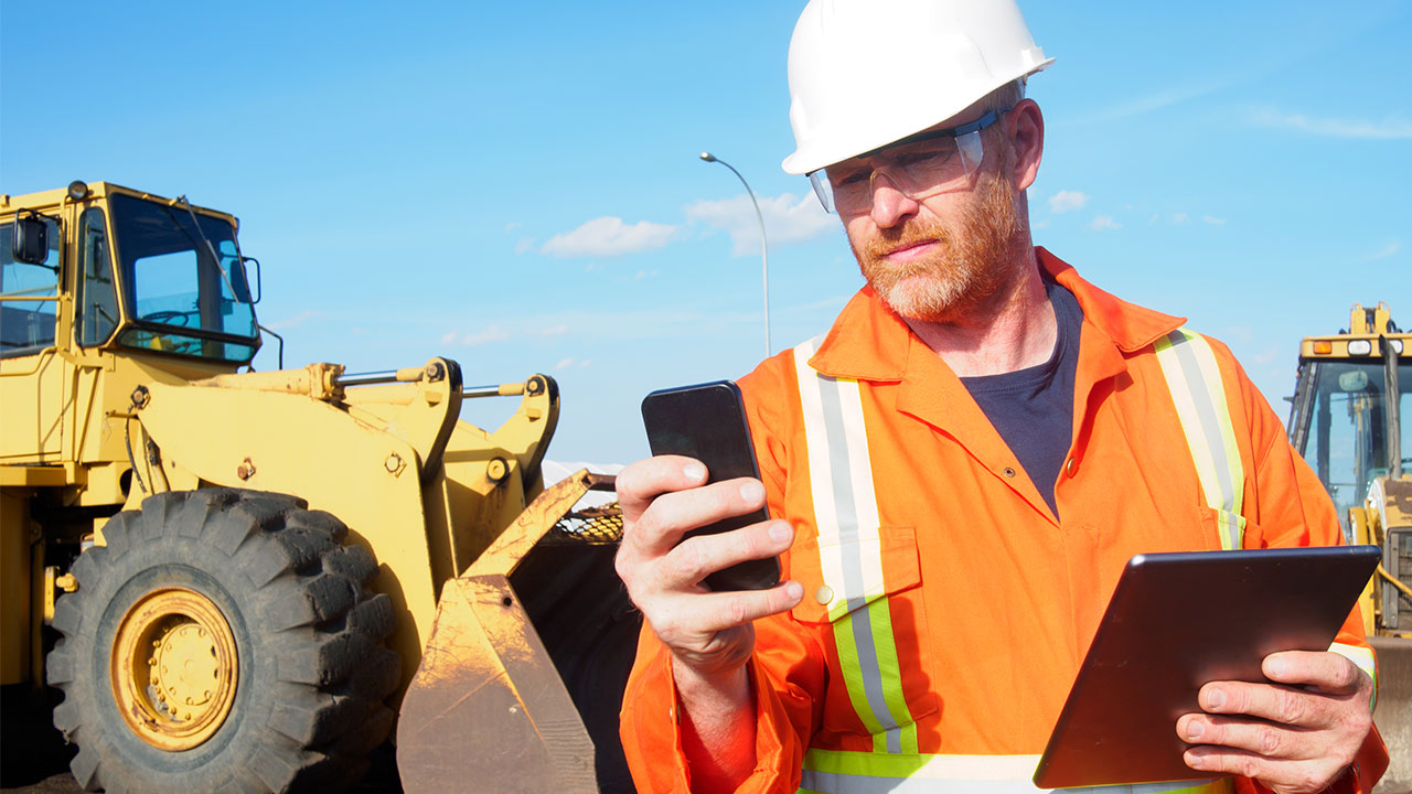 construction worker with iphone and ipad