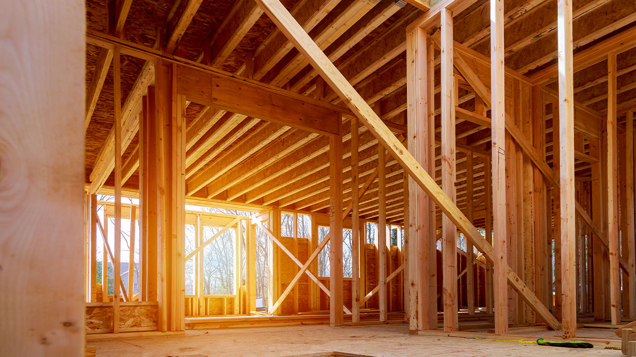 Interior view of wooden frame of a house under construction