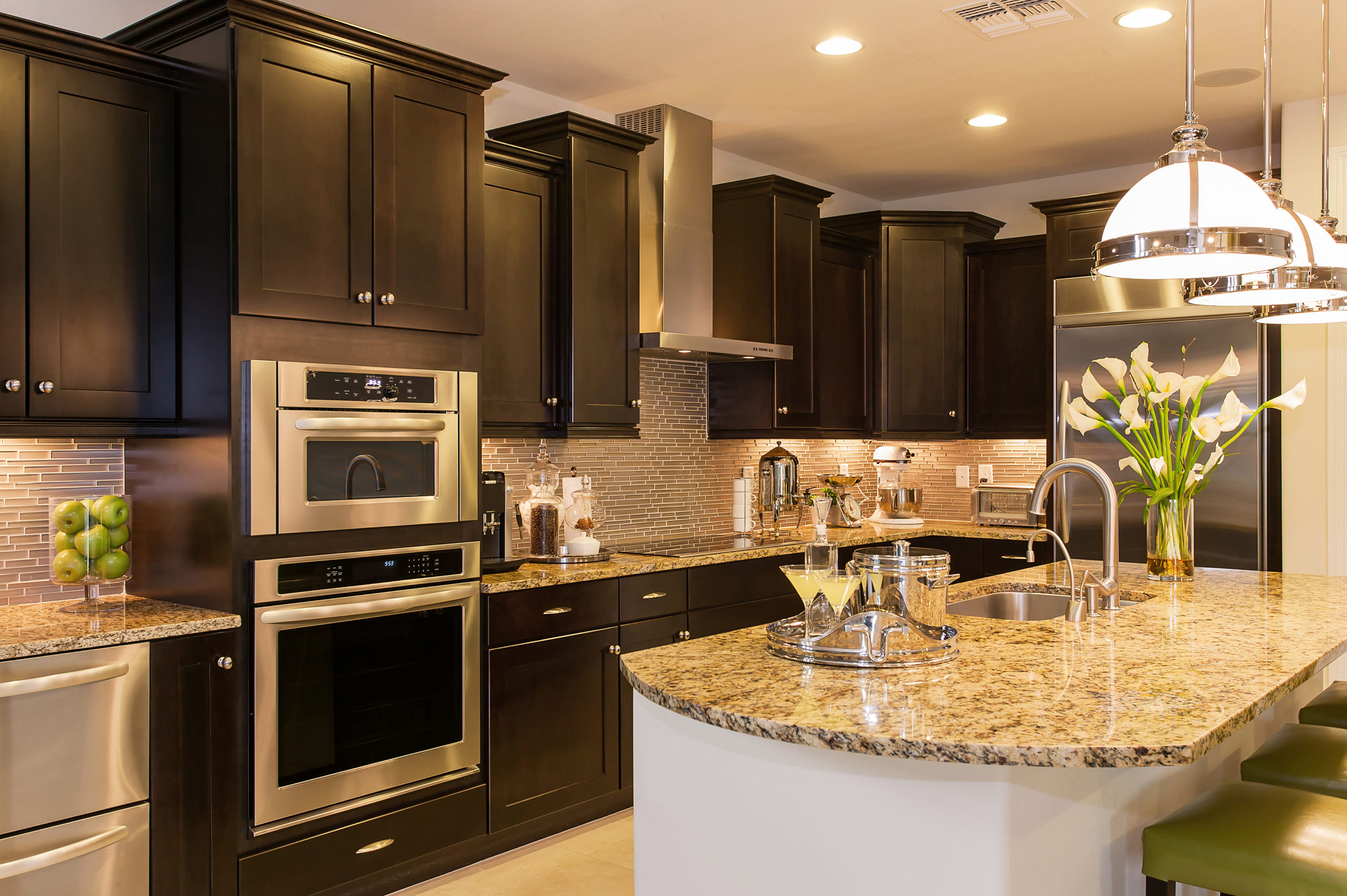 Luxury kitchen with black cabinets and large island