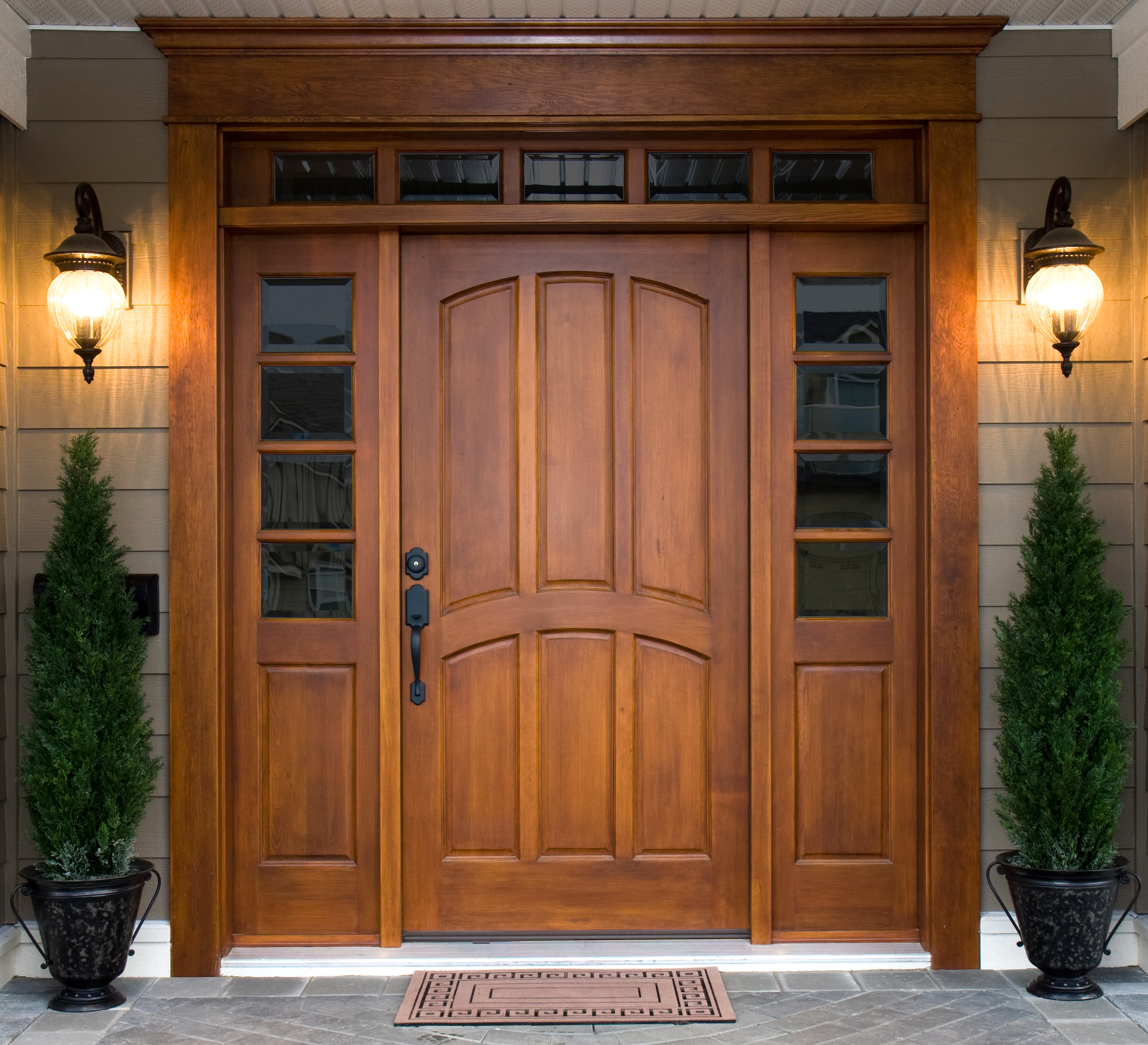 Beautiful wooden front door framed by windows