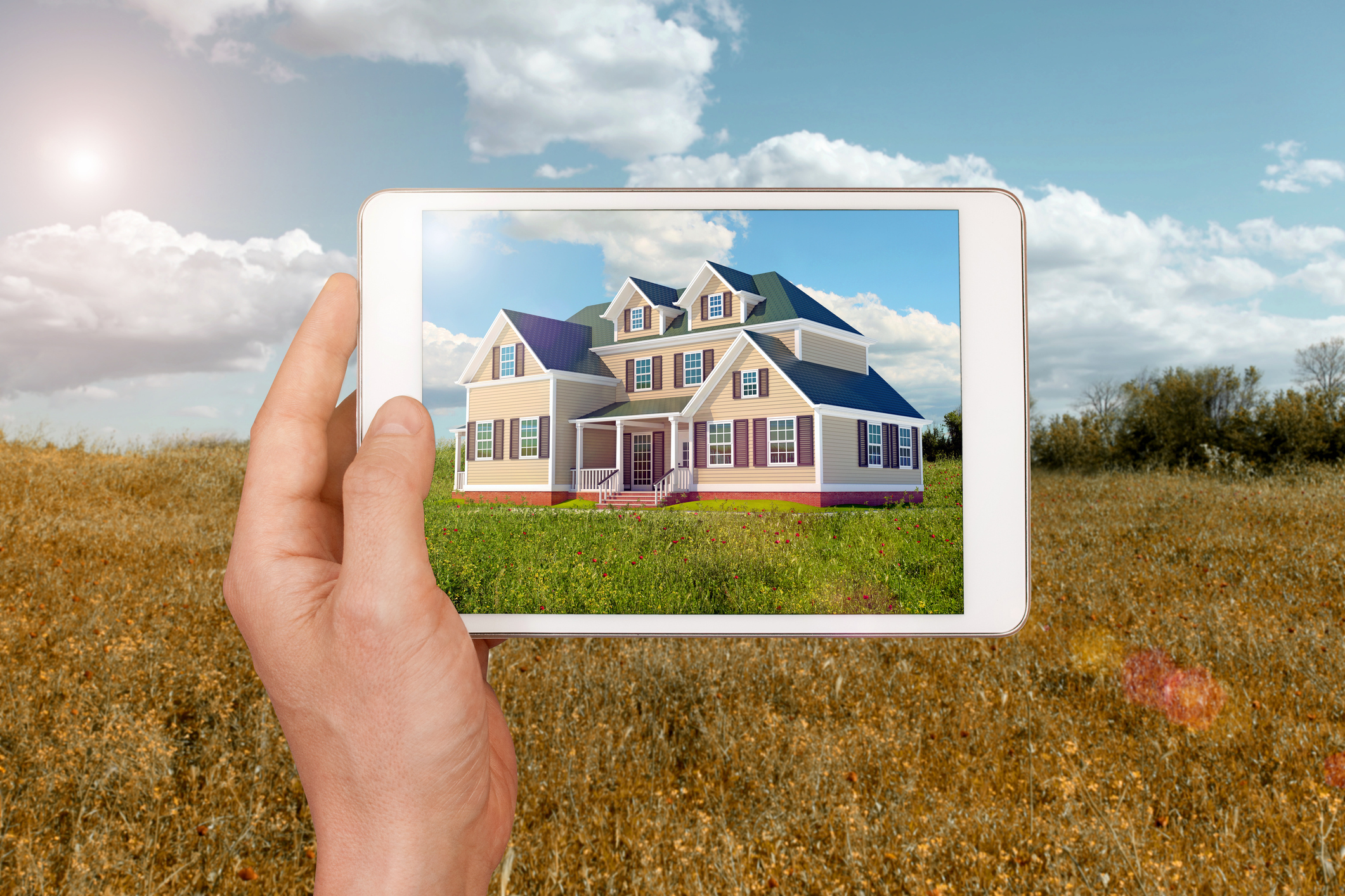 Tablet computer showing image of a new house to build